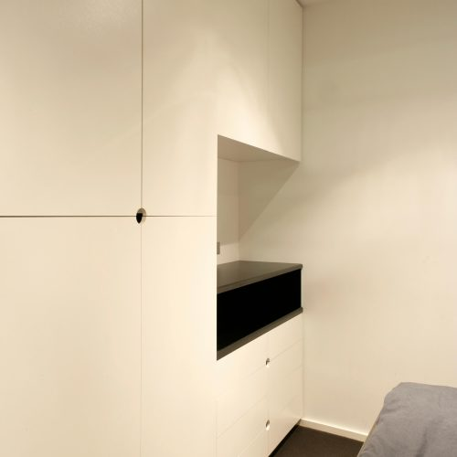 Opat Architects Infill South Yarra photo of bedroom cabinetry